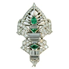 Art Deco, Diamond, Platinum and Emerald French Clips | From a unique collection of vintage brooches at http://www.1stdibs.com/jewelry/brooches/brooches/