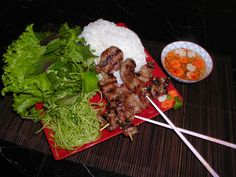 Noodle dish (Bún Chả):  Vermicelli noodles with grilled pork meatballs served over salad, herbs, bean sprouts, and sliced cucumbers
