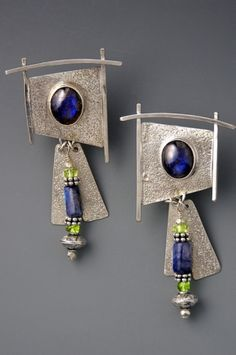 Textured silver earrings set with Labradorite cabachons. Silver, peridot and Labradorite dangles. (Contemporary Jewelry)