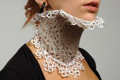 Francesca Lanzavecchia and Hunn Wai. Opposing the iconic thick and rigid image neck braces have, delicate lace is coated with flexible plastic to support the neck in the style of a Victorian collar. The perforations inherent in the lace pattern naturally ventilate the supported area as well.