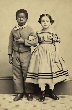 Pictured are Isaac White and Rosina Downs. They both were slave children in New Orleans, and were emancipated in 1864 when General Butler took New Orleans