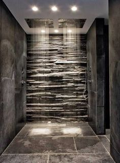 Gorgeous, textured, natural shower with grey slate & cladding.