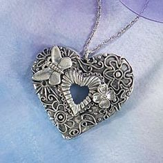 Pewter Floral Heart Necklace with butterfly.  That just about does it for me!