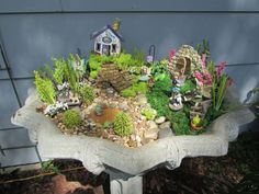 Creating a Fairy Garden Out of a Old Cement Flower Urn....