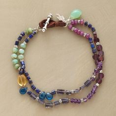 """JEWEL KINGDOM BRACELET--Loaded with lapis, ruby, amethyst, iolite, garnet, chrysoprase, apatie and citrine, to wear with everything. Sterling silver toggle clasp. Handcrafted exclusively for Sundance. 7-1/2""""L."""