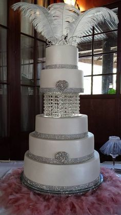 Elegant Personalised multi-tier Wedding cake with chandelier and swarovskiCrystals