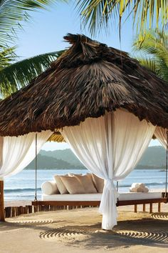 The white-sand beach has private palapas for couples to collapse in relaxation. #Jetsetter