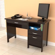 Organize your work area more efficiently with this sleek espresso computer desk. This desk features a storage area, one accessory drawer and one file drawer. A slide out keyboard shelf concealed by a mock center drawer adds to the smart style.