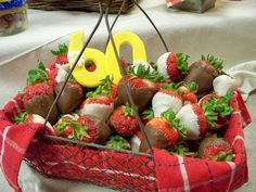 Our basket of fresh strawberries dipped in chocolate completed with chocolate molded '60' with flower detail