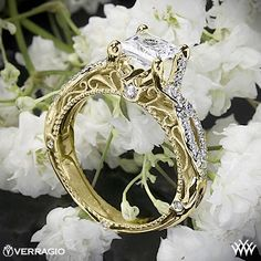 This Diamond Engagement Ring is from the Verragio Venetian Collection. It features 0.25ctw of Round Brilliant Diamond Melee (F/G VS) that enhance a princess diamond center of your choice. The width tapers from 4mm at the top down to 3.3mm at the bottom. Select your diamond from our extensive online diamond inventory. Please allow 4 weeks for completion. Platinum rings carry a 5 week turnaround time. If you have any questions regarding this item then please contact one of our friendly diamond…