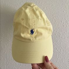 Vintage Polo hat This light yellow vintage Polo hat is detailed with navy  blue stitching! 05e57e20b47