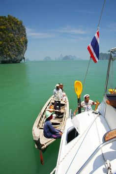 Fish for dinner !  Our cook negotiates with the locals - it doesn't get any fresher than this.   (Sailing in Thailand)