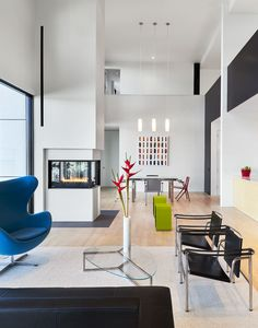 Arne Jacobsen Egg Chair and Le Corbusier LC1 Sling Chairs in Maryland living room.