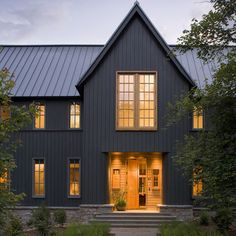 Our favorite modern take on the farmhouse? Dark gray or black exteriors.