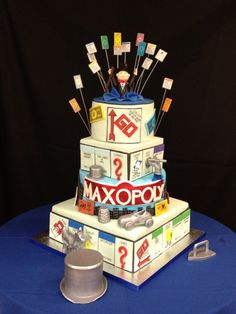 Monopoly Themed Bar Mitzvah Cake - 4 Tier Bar Mitzvah cake with a monopoly theme. Everything is edible and hand scripted.