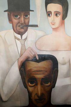 het koppel afgebeeld op het schilderij van August GILLÉ met als titel 'Ze hebben voor ons gestreden' Dhr. Paul-Gustave VAN HECKE en zijn vrouw Norine DE SCHRIJVER is. VAN HECKE (1887-1967) was kunstcriticus, verzamelaar, kunsthandelaar, galerist, couturier, dichter, cineast, theaterman en politiek geëngageerd in de Belgische Werkliedenpartij.