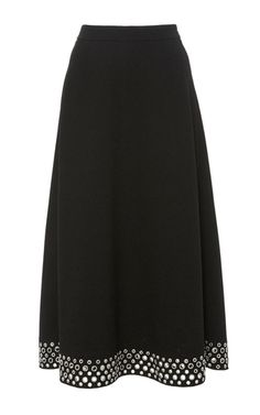 Rendered in a boucle crepe, this **Alexander Wang** skirt features a high waist with a midi length a-line silhouette and grommet details at the hem.