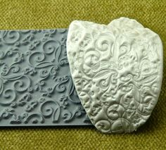 Anniversary titled rubber texture mold for rubber stamping, clay jewelry designs using a soft clay, scrapbooking, card making, collage, printing on silk….and making intristic designs using ink and/or acrylic paints. The uses are endless in the artistic world of creative souls. These are the smallest of the rubber texture tile stamps I sell measuring 2 x 4