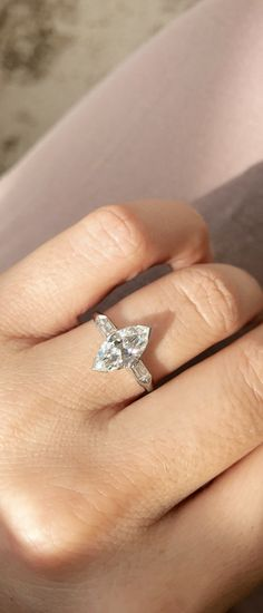 The Helena ring from Victor Barboné Jewelry centers a stunning 1.53ct marquise cut diamond with baguette sidestones in an Art Deco vintage platinum setting with a low profile!