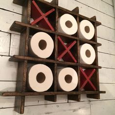 This toilet roll holder/rack in a tic tac toe style will be a good talking point in your bathroom when people will visit you. Comes with 3 wooden hand crafted X. Please note that toilet rolls are not for sale. This item has imperfections, nail holes etc. because it is made from reclaimed scrap wood in the style of rustic. It is unique and truly one of a kind. No two will be alike. Size approx: 65cm x 65cm