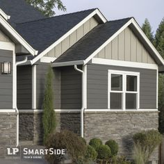 LP SmartSide trim, lap and panel siding pair with horizontal stonework to create dimension and excitement on this home's exterior.