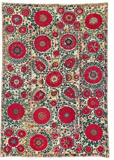 Shakhrisyabz Suzani, Central Asia, Uzbekistan, 273 x 190 cm, Mid 18th century. A magnificent Shakhrisyabz silk embroidery on a six-panel cotton ground. The field shows a classic four-and-one composition of circular, brilliant red poppy blossoms linked by lively green twigs. Eight palmettes radiate out from the central blossom. The field design is symmetrically conceived around the vertical as well as the horizontal central axes.
