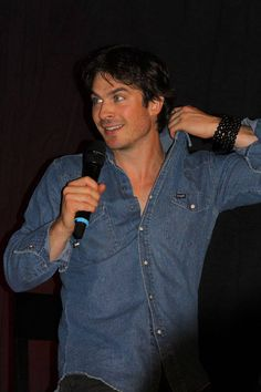 Ian Somerhalder, fidget guy, is always messing with his collars. I really believe he would rather be naked.