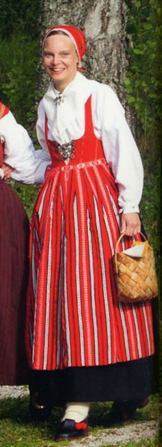 Swedish traditional costume ... in reds ...