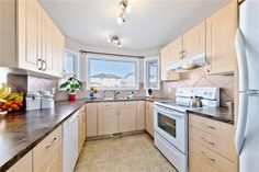 Kitchen has upgraded tile back splash, built-in filtered water on the sink, & a walk-in pantry w/ french door. Diamond Realty & Associates Ltd. Selling Real Estate, Walk In Pantry, Home Buying, French Doors, Open House, Backsplash, Tile, Kitchen Cabinets, Diamond