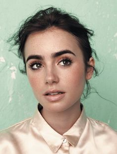 Beautiful natural makeup on Lily Collins bold brow + doe eyes