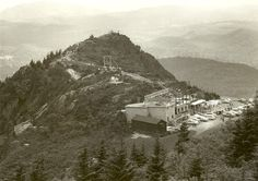 """Grandfather Mtn. """"Here's a recently discovered blast from the past. We hadn't really seen any photos of the old Top Shop being built until this one. The building was open from 1961-2008.  Before this building was built, the small building with the dark wood exterior was the gift shop at the top. The platform that you can see to the left of the approach to the Swinging Bridge had weather equipment on it. Also, notice that the parking lot is much smaller than it is today.""""  Photo by Hugh…"""