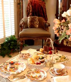 Afternoon Tea for two with my husband's favorite chair. Olde Avesbury china by Royal Crown Derby.  Photo by Lady Glynstewart.