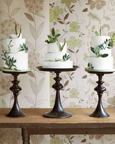 A Trio of Cakes - vegan & gluten-free weddings cakes on stunning wood cake stands at a gay wedding featured in Martha Stewart Weddings. For more ideas & inspiration for gay & lesbian weddings, please like https://www.facebook.com/onelovewed