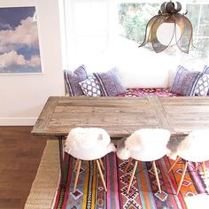 Layered rugs? Check. Pillows of various sizes? Double check. And fuzzy chairs…