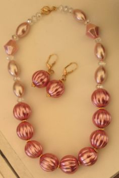 Juego en perla rosado.