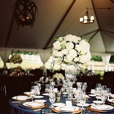 Wedding tablesetting ideas--elegant black and white with gold and green accents.