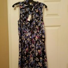 Great dress for a wedding or shower! Flowered dress that I planned to wear but never did! Bought at white house black market.  Great for a shower or if attending a wedding! Great quality and very flattering! Willing to negotiate on price!!! black house white market  Dresses Mini