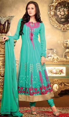 Make your onlookers fall in your beauty dressed up in this greenish blue embroidered georgette Anarkali suit. The resham work looks chic and ideal for any function. #LovelyEveningWearDress