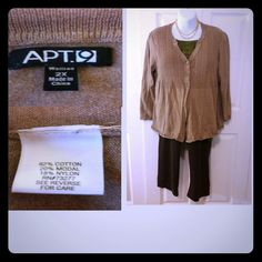 Tan sweater with high low hem line 3 button tan sweater by Apt. 9 has a high low hem line and pleated front and back and cable design on upper part of sweater nice lightweight material. Which is a mix of cotton/ modal/ nylon. Very soft comfy sweater.  Pair it up with the top shown available on my closet and your favorite pair of jeans or dress pants. Apt. 9 Sweaters Cardigans