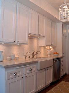 galley kitchen with white shaker style cabinets