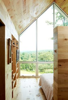 An 800-square-foot addition expands the Virginia home of Lauren and Josh Stegall. Built for $120,000, the structure has a large window overlooking the Blue Ridge Parkway and Sugarloaf Mountain.