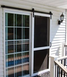 13 Country Chic Ways to Refresh a Screen Door Include some barn style to the back of your home by installing a sliding screen door. Get the tutorial at Planted and Blooming Girl.<br> Because it's not a country house without a screen door. Diy Screen Door, Sliding Screen Doors, Screens For French Doors, Exterior Sliding Doors, French Doors Patio, Exterior French Doors, Farmhouse Patio Doors, Farmhouse Kitchens, Farmhouse Style