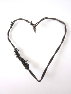 Barbed wire heart. I think we all have a developed few barbs around hearts trying to protect ourselves from hurt.
