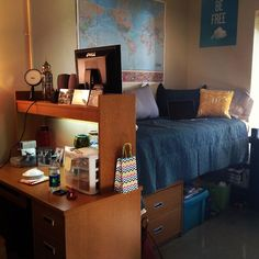 I like how the room is arranged with the desk at the end of the bed. It separates it nicely and keeps studying and sleeping away from each other.
