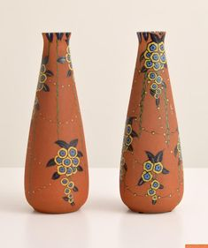 Pair of large Auguste Heiligeinsten for Leune Vases. Thick enamel with delicate floral designs. Circa 1930s.