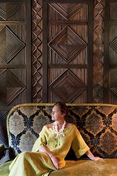 Woman relaxing in the Library room at restaurant Le Marocain of Hotel La Mamounia in Marrakech