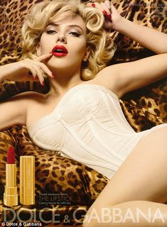 Here's a advert from Dolce & Gabbana showcasing Scarlett Johansson. In this ad she appears to be wearing underwear, leaving a majority of her body uncovered. She has the curly blonde hair and red lipstick. All of which point out that she is a very feminine women. In this advert she is portrayed as being a very rich, seductive, beautiful women.
