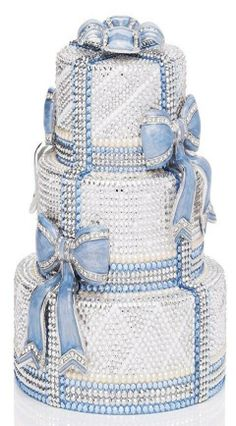 """This showstopping wedding-cake minaudiere by Judith Leiber features blue detailing - and a """"something blue"""" lining"""