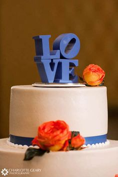 "Philly wedding: Love! This would be cute in Red & Blue with a little Phillies couple on top with the ""Love""!"