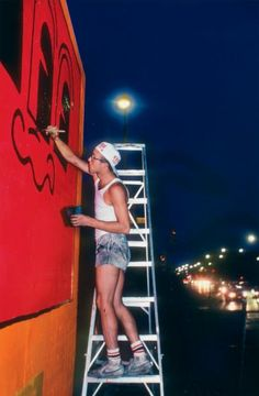 Keith Haring painting the Houston/Bowery Wall in 1982, photograph by Martha COOPER